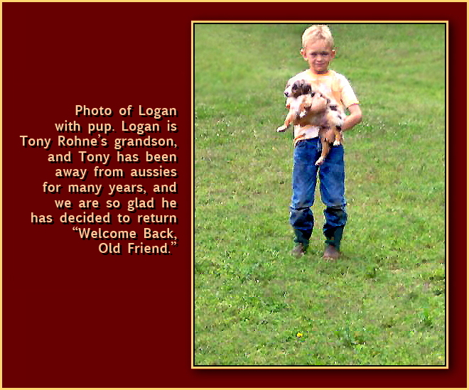 Photo of Logan with pup.